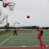 Newburyport: Cashman Park was a busy spot on Patriot's Day despite the cool wind from the ocean. Crystal Huang, 8, of Newburyport spent time practicing her basketball shots.