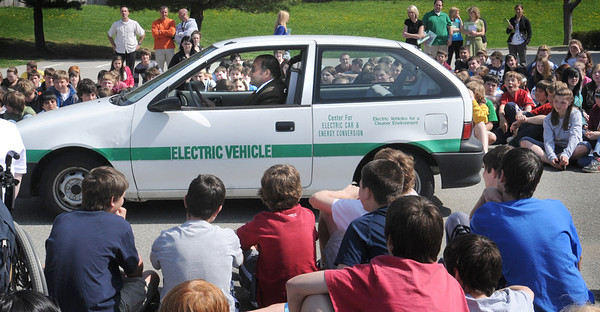 Newburyport: Professor Ziyad Salameh, Director of the Center for Electric Cars and Energy Conversion at University of Massachusetts/Lowell spoke on renewable energy at the Nock Middle School in Newburyport. Here, he pulls away in an electric car he built to the awe of the students Bryan Eaton/Staff Photo  Newburyport News  Thursday April 30, 2009.