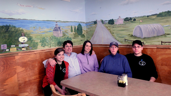 Newbury:<br /> The crew at Plum Crazy under a mural that takes one to the intersection of Ocean Avenue and Plum Island Turnpike. From left, server Kat McCarron, owners Kurt Littlefield and Jeanne LaCroix, manager Trish Cram and chef Sergio Julien.<br /> Photo by Bryan Eaton/Newburyport Daily News Friday, April 10, 2009