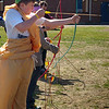 Seabrook: Dressed in a yellow toga, Seabrook Middle School seventh-grader Cameron Hauze takes aim with bow and arrow during an archery match. They were celebrating Greek Day and having their own version of the Olympics. Photo by Angeljean Chiaramida/ Newburyport  Daily  News Thursday, April 23, 2009.