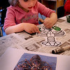 Newbury: Madison Murray, 4, paints in the outline of a lobster in Mary Jo Lagana's preschool class at Newbury Elementary School on Thursday. The children were learning about color and the three pigments in a lobster's shell which are red, blue and green. Bryan Eaton/Staff Photo  Newburyport News  Thursday April 30, 2009.