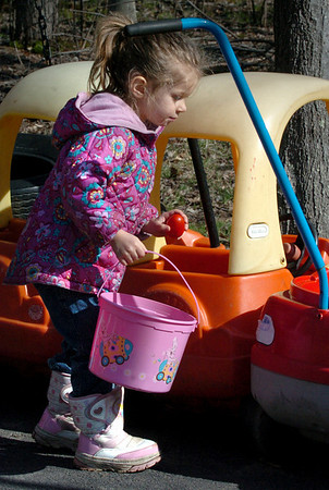 Salisbury:<br /> Danielle Jacobs, 3, plucks an egg during the annual Easter Egg hunt at Little Inspirations Daycare in Salisbury. The Easter Bunny also made an appearance to the delight of the children.<br /> Photo by Bryan Eaton/Newburyport Daily News Friday, April 10, 2009