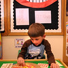 Newbury:<br /> Timothy Carter, 4, puts different pieces of toppings on a fake pizza in MaryJo Lagana's preschool class at Newbury Elementary School on Tuesday afternoon. Teaching assistant Shirley Locke was teaching the youngsters about the food pyramid that can be a applied to pizza, then gave them cards of different numbers of toppings with which they counted out to put on the pizza helping them with their math skills.<br /> Photo by Bryan Eaton/Newburyport Daily News Tuesday, April 07, 2009