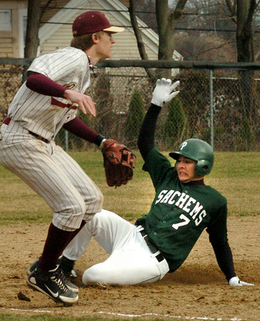 Newburyport:<br /> Pentucket's Sean Milley makes it past Newburyport third basemenTyler Stotz on a popup from a teammate that was caught.<br /> Photo by Bryan Eaton/Newburyport Daily News Wednesday, April 08, 2009