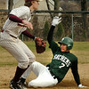 Newburyport:<br /> Pentucket's Sean Milley makes it past Newburyport third basemenTyler Stotz on a popup from a teammate that was caught.<br /> Photo by Bryan Eaton/Newburyport Daily News Wednesday, April 08, 2009