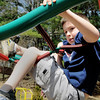 Amesbury: Outside gym was popular yesterday as temperatures were more seasonable then the mid-90's on Tuesday. Alex Griffin, 8, who takes gymnastics, was having fun on the monkey bars at the Cashman School in Amesbury.