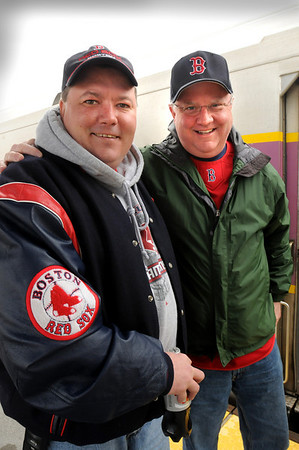 Newburyport:<br /> Bob Graham, right, and Sean Donahue ready to board the train to Boston yesterday for the Red Sox season opener. Graham, of Portsmouth, N.H., treated several of his employees, including Donahue, to the game, and had also gone in on Monday before learning the game had been canceled only five minutes from the station.<br /> Photo by Bryan Eaton/Newburyport Daily News Tuesday, April 07, 2009
