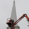 Newbury:A crane gets a close as it can   to he steeple of the First Parish Church in Newbury with the replical rooster weathervain which unfortunatly could not be installed on Saturday due to high winds.JIm Vaiknoras/Satff photo