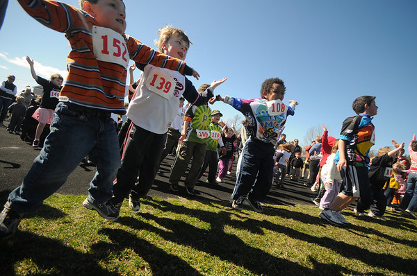 "Newburyport: Participants warm up before the start of  ""Running Wild"" a childerns race at Fuller Field in Newburyport Sunday.The series of age divided races raised money for the Pan Mass Challenge supporting the Jimmy Fund and Dana Farber. Jim Vaiknoras/Staff photo"