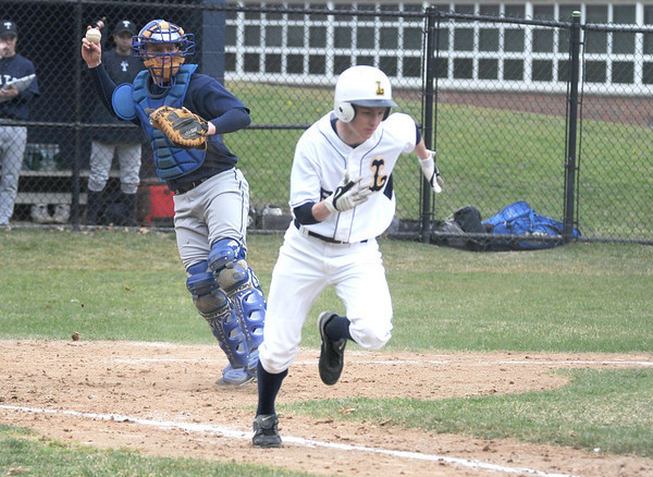 Lynnfield: Triton catcher Andrew Fecteau throws out a Lynnfield runner during their game at Lynnfield Saturday. Jim Vaiknoras/Staff photo
