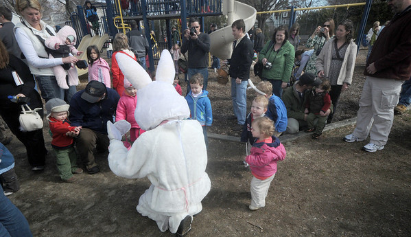 Newburyport: Participants in this years Newburyport Mothers' Club Easter egg hunt at Perkin's Park greet the Easter Bunny Saturday morning. Jim Vaiknoras/Staff photo