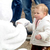 Newburyport: Greta Conway, 1, greets the Easter Bunny Saturday morning at the Newburyport Mothers' Club Easter egg hunt at Perkin's Park . Jim Vaiknoras/Staff photo