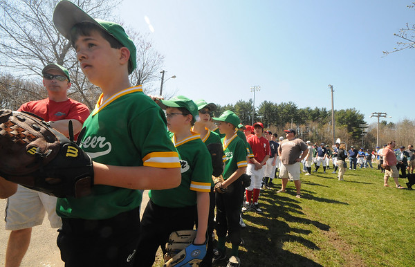 Newburyport: Players line up to enter the field at the Pioneer League Opening Day ceremonies at Pioneer Park in Newburyport Saturday. Jim Vaiknoras/Staff photo