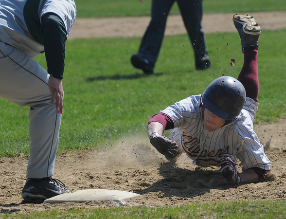 Newburyport:Newburyport's Kyle LeBlanc kicks up some dirt as he dives back safetly to first during the Clippers game against Manchester Essex Saturdat at the Lower Field in Newburyport. Jim Vaiknoras/staff photo