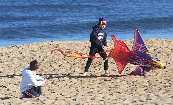 Newbury:Marin MacDonald, 7, and his brother Drew,5, help their friends Julia and Nicolas D'Onofrio fly a kite on Plum Island Sunday. Jim Vaiknoras/Staff photo