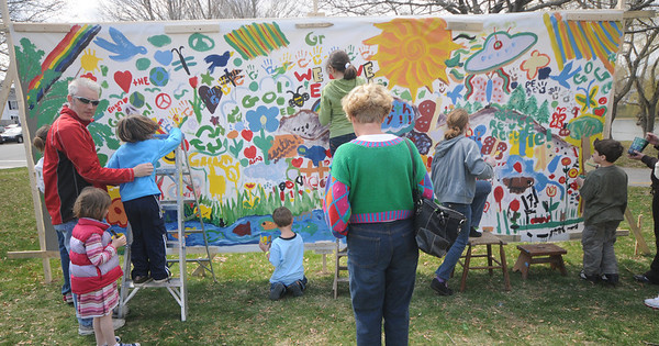 Newburyport: Kids and adults alike paint a big mural at the Earth Day celebration on the Bartlett Mall Saturday. Jim Vaiknoras/Staff photo