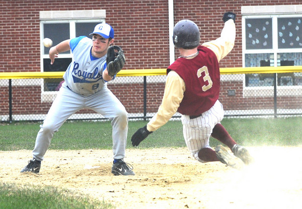 Georgetown: Newburyport High's Kyle McElroy steals 2nd just under the tag of Georgetown's Anthony Cote during their game at Georgetown Saturday. Jim Vaiknoras/staff photo