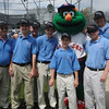Byfield; The umpires with Wally the Green Monster at the Byfield/Newbury Little League Opening Ceremonies. This year marks the begining of the town's affiliation with Little League.Jim Vaiknoras/Staff photo