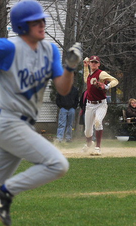 Georgetown: Newburyport High's Kyle McElroy throws out a runner at first during the Clippers game at Georgetown Saturday. Jim Vaiknoras/staff photo