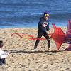 Newbury:Marin MacDonald, 7, and his brother Drew,5, help their friends Julia and Nicolas D'Onofrio fly a kite on Plum Island Sunday. Jim Vaiknoras/Staff photo