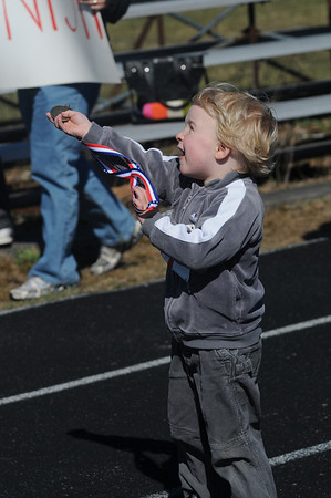 "Newburyport: Finn Ingalls, 3, shows off his medal after his race in ""Running Wild"" a childrens race at Fuller Field in Newburyport Sunday.The series of age divided races raised money for the Pan Mass Challenge supporting the Jimmy Fund and Dana Farber. Jim Vaiknoras/Staff photo"