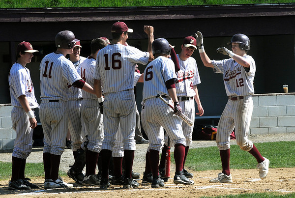 Newburyport: Newburyport's Tyler Stotz is congratulated by his teammates after homering  Saturday against Manchester Essex at the Lower Field in Newburyport. Jim Vaiknoras/Staff photo