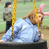 Newburyport:Celia Celona, 7, rides the tire swing at the Newburyport Mothers' Club Easter egg hunt at Perkin's Park. Jim Vaiknoras/Staff photo