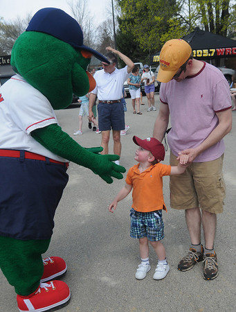 Byfield; Charlie Breen and his son William, 3, say hi to Wally the Green Monster at the Byfield/Newbury Little League Opening Ceremonies. This year marks the begining of the town's affiliation with Little League.Jim Vaiknoras/Staff photo