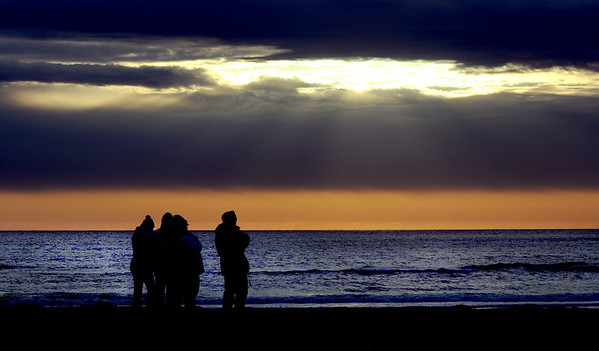 Salisbury: A small group of people watch the sunrise on Salisbury Beach Easter morning.Jim Vaiknoras/Staff photo