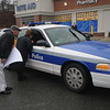 Amesbury:Sumner Delaney and Jeannine Perley give a hand out to Amesbury Police  Sargent William Shultz in the Rite-Aid in Amesbury.  The two were at the lot handing out information about the Employee Free Choice Act.Jim Vaiknoras/Staff photo