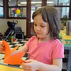 Newburyport: Haydn Shaw, 5, makes a butterfly out of construction paper  after listening to Illustrator Judith Moffatt read one of her books at the Childrens Room of the Newburyport Library at the Newburyport Literary Festival saturday. Jim Vaiknoras/Staff photo