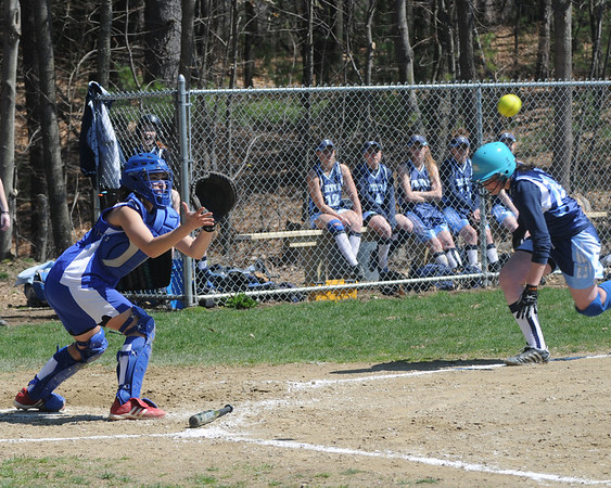 Georgetown:Georgetown's Melanie Prior waits for the throw before tagging out Triton's Marissa Strangie at the plate during the Royal's game at home agianst Triton.Jim Vaiknoras/Staff photo