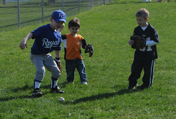Amesbury: JT Tilton, 5, Brenden Lopez, 2, and Lucas Lopez, 5, plays some catch  on Opening Day for the Amesbury Little League Saturday. Jim Vaiknoras/Staff photo