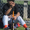 Amesbury: Kevin Kaneb, 12, takes a break before his game on Opening Day for the Amesbury Little League Saturday. Jim Vaiknoras/Staff photo