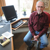 "Amesbury: George Cope of Amesbury at his home office wih his  his first novel, ""Cora's Turn."" both in print and on a Kindle.Jim Vaiknoras/staff photo"