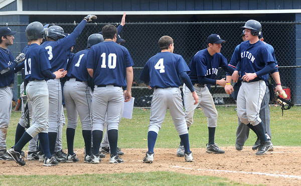 Lynnfield: Triton catcher Andrew Fecteau is congradulated by his teammates after hitting a homerun  at Lynnfield Saturday. Jim Vaiknoras/Staff photo