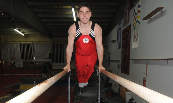 Salisbury:Noah Piotte, gymnast from Haverhill, works out on the parallel bars at All-Around Gymnastics in Salisbury.Jim Vaiknoras/staff photo