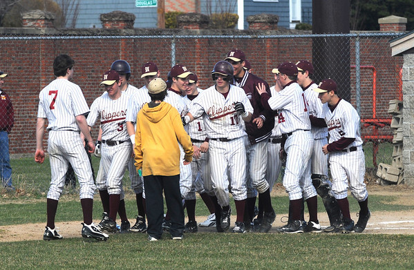 Newburyport:Newburyport's Matthew Mottola is congratulated by his teammates after his first inning homerun at Haverhill Sunday afternoon.Jim Vaiknoras/staff photo