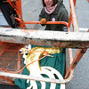 Newbury: Rev Nancy Haverington looks over the replical rooster weathervain that unfortunatly could not be installed on the steeple of the First Parish Church in Newbury Saturday due to high winds.JIm Vaiknoras/Satff photo