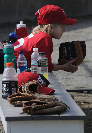 Amesbury: Adam Lane of the Nationals waits to take the field against the Marlins on Opening Day for the Amesbury Little League Saturday. Jim Vaiknoras/Staff photo