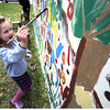 Newburyport: Caroline Walsh, 6, of Newburyport, puts her mark on a large mural at the Earth Day celebration on the Bartlett Mall Saturday. Jim Vaiknoras/Staff photo