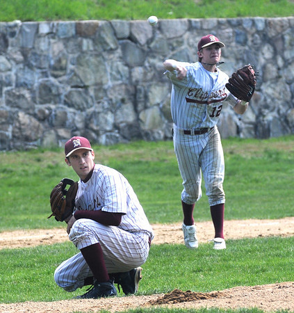 Newburyport: Newburyport's David Grabowski ducks as Tyler Stotz throws out a runner at first  during the Clippers game Saturday against Manchester Essex at the Lower Field in Newburyport. Jim Vaiknoras/Staff photo