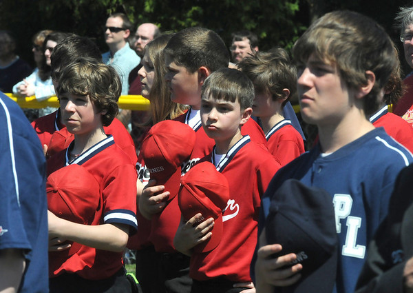 Newburyport: Player cover their heart for the National Anthem at the Pioneer League Opening Day ceremonies at Pioneer Park in Newburyport Saturday. Jim Vaiknoras/Staff photo