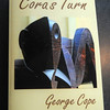 """Amesbury: George Cope of Amesbury at his home office wih his  his first novel, """"Cora's Turn."""" both in print and on a Kindle.Jim Vaiknoras/staff photo"""