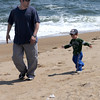 Salisbury: Richard Vargus and his son Richard, 2, jog along Salisbury Beach Monday afternoon. Originally from Amesbury the two live in North Conway and stopped by the beach on their way to Cape Cod. Jim Vaiknoras /Staff photo