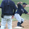 Lynnfield:Triton first baseman Mike Speicher tags fthe bag just before a diving Lynnfield player during their game at Lynnfield Saturday. Jim Vaiknoras/Staff photo