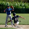Rowley: Catcher Derek Paquette slides into the bag while stealing second base in Triton's game against Timberlane Monday night in Rowley. Photo by Ben Laing/Staff Photo