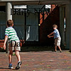 Newburyport: Nick Acquaviva pitches a tennis ball to Sam Lincoln on Inn Street Sunday afternoon. Photo by Ben Laing/Staff Photo