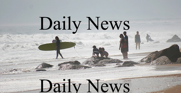 Newbury: Surfers and beachgoers flocked to Plum Island on Monday to see the waves churned up by Hurricane Bill. Photo by Ben Laing/Staff Photo