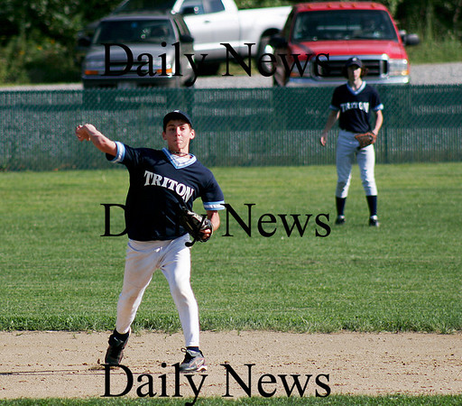 Rowley: Shortstop Matt Hill of Triton fires to first base after scooping up a Timberlane grounder in Monday night's Babe Ruth game in Rowley. Photo by Ben Laing/Staff Photo